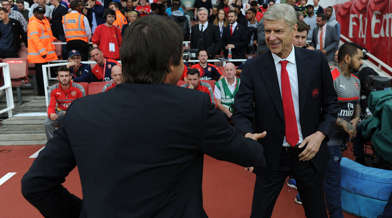 Arsene Wenger shakes Antonio Conte's hand during a 3-0 Arsenal win over Chelsea