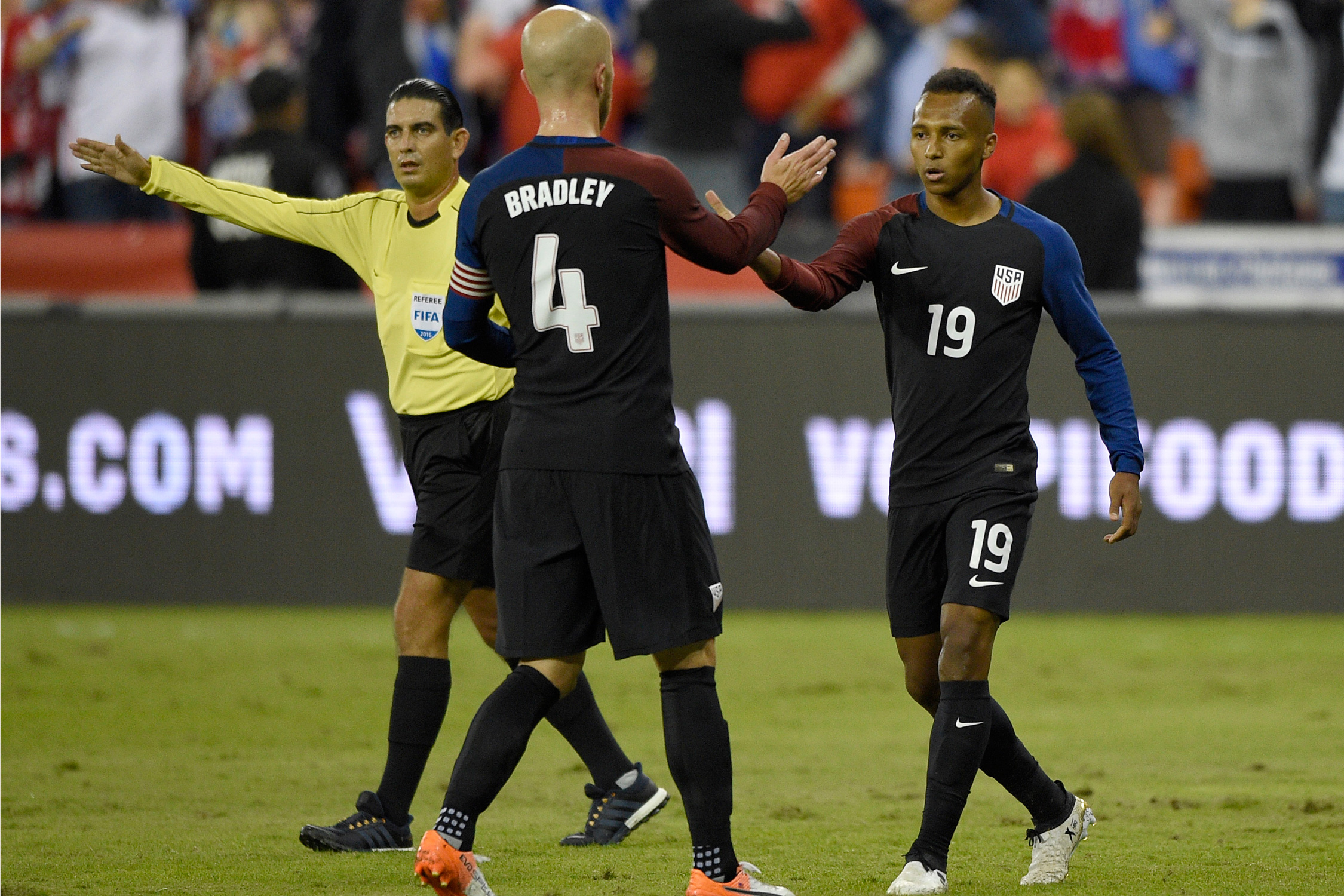 Julian Green is congratulated by captain Michael Bradley after scoring the opener, but the U.S. was forced to settle for a 1-1 draw vs. New Zealand in the last game before the CONCACAF World Cup qualifying Hexagonal kicks off.