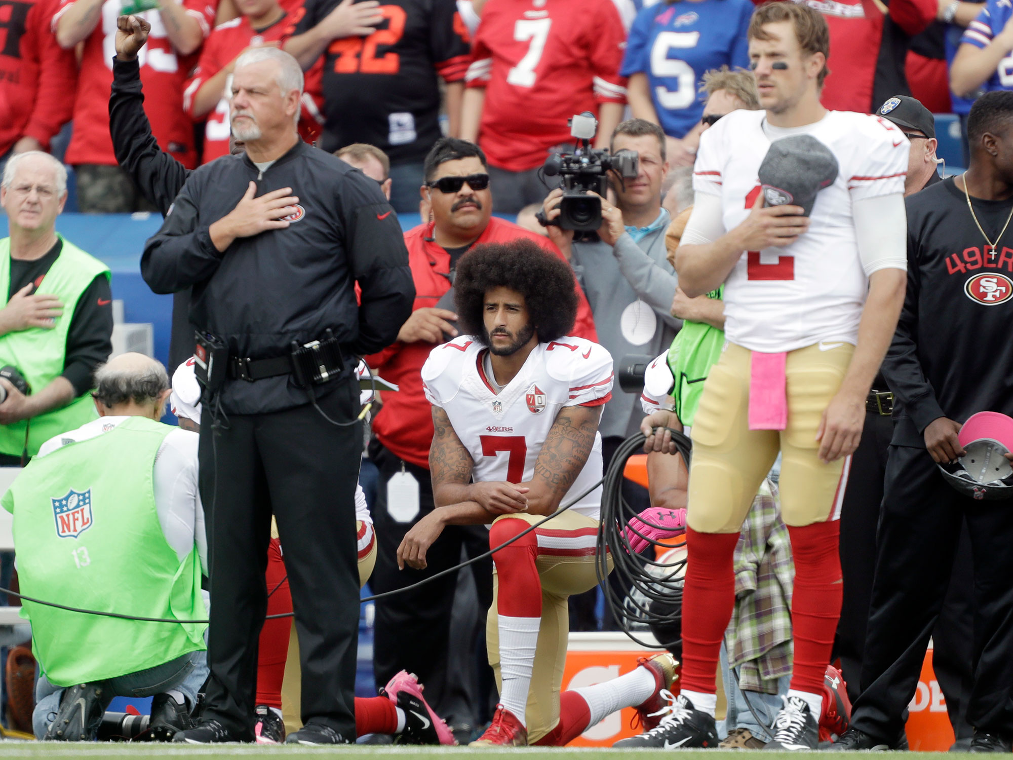 "Ratings have skyrocketed in an era of scandal (Spygate, Bountygate, DeflateGate). But many argue Kaepernick protesting the national anthem is different.  Certain polls support that notion—32% of respondents in a Rasmussen Poll in early October said they were less likely to watch a game because of the 49ers quarterback. What started as concern for criticism of police and the military has developed into a discussion of players protesting anything. The argument is that athletes get paid a lot of money to entertain us, not to inform us of their political views. Colts owner Jim Irsay explained this theory to USA Today's Jarrett Bell: ""I think it's the wrong venue. It hasn't been a positive thing.""  The Kaepernick factor could be proved if college ratings continue to hold steady or rise. That would mean the demand for football on TV is still the same, but the NFL brand is now less attractive. That doesn't mean fans won't watch their own team, but if you're a marginal fan or live in a state without a pro team, perhaps Kaepernick is enough to make you watch less pro football."