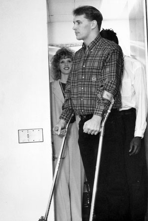 With his wife, Angela, behind him, Byrd walks into his press conference at Mount Sinai on Feb. 11, 1993.