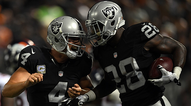 Derek Carr and Latavius Murray celebrate after a touchdown against Denver.