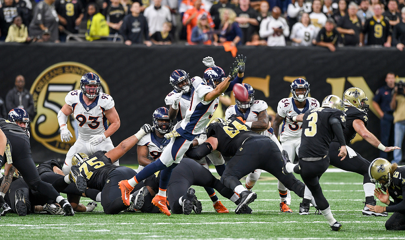 Broncos rookie Justin Simmons blocked the go-ahead extra-point attempt by the Saints.
