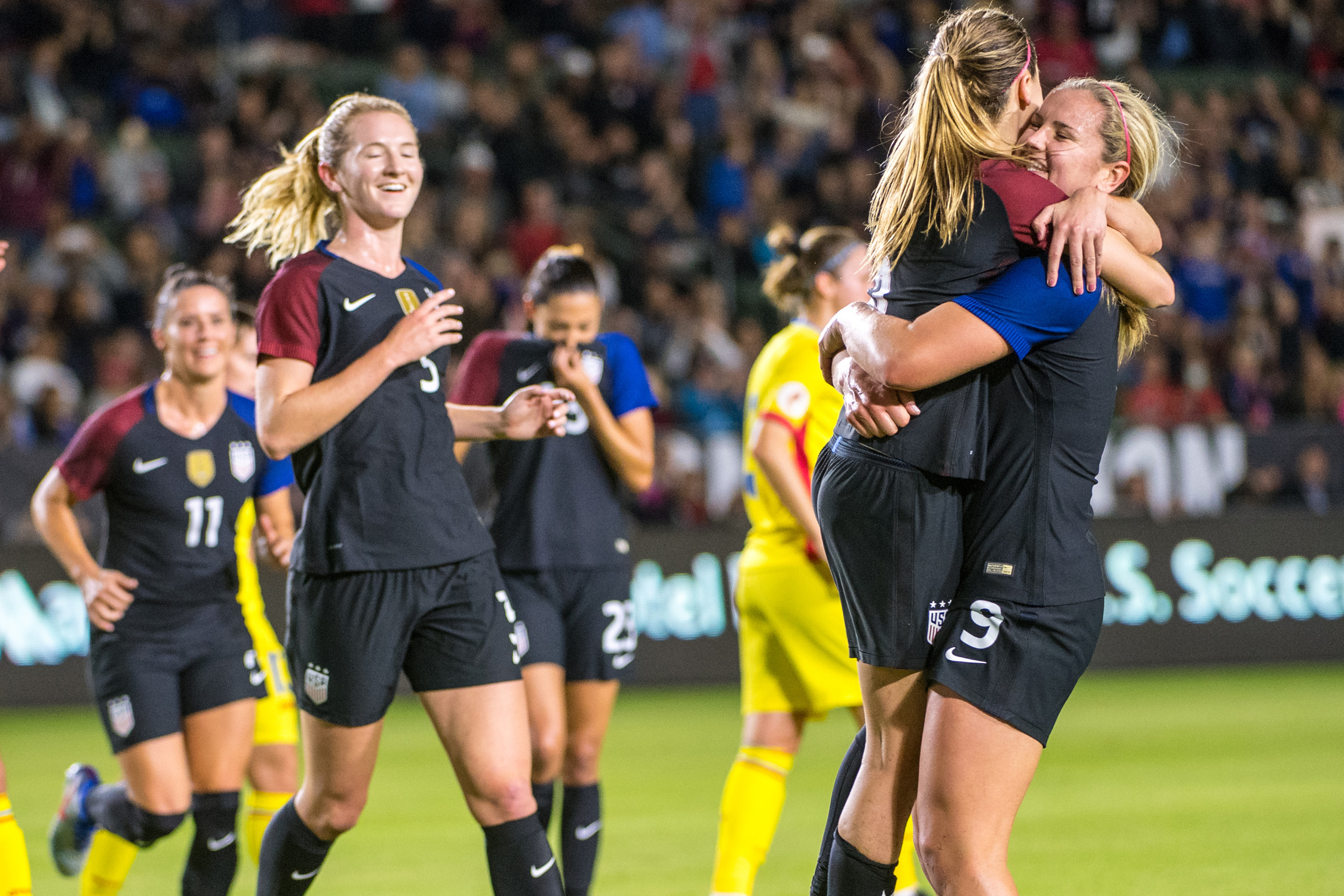 Morgan Brian gets a congratulatory hug after her converted penalty kick, which helped the U.S. women close out 2016 with a 5-0 rout of Romania at StubHub Center in Carson, California.