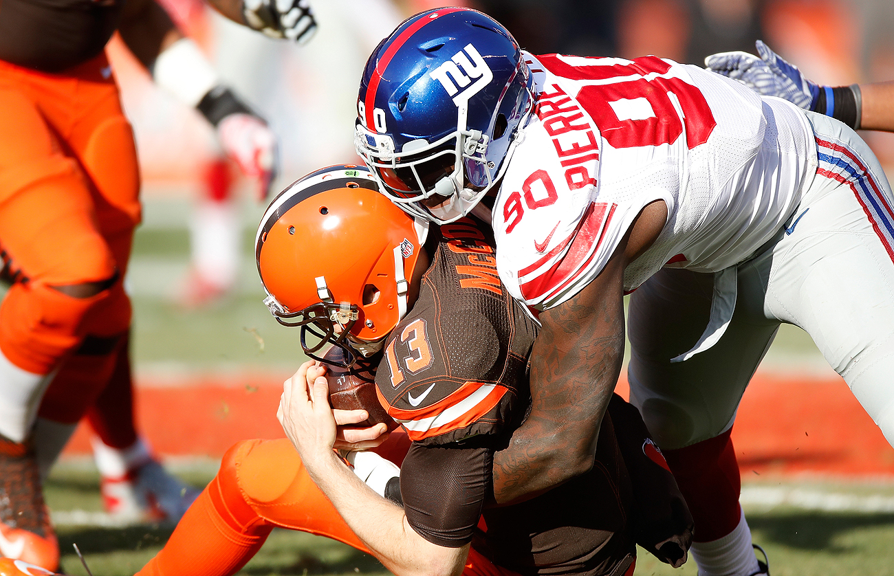 The Giants lived in the Cleveland backfield, recording seven sacks and eight tackles for loss in Sunday's victory over the winless Browns.