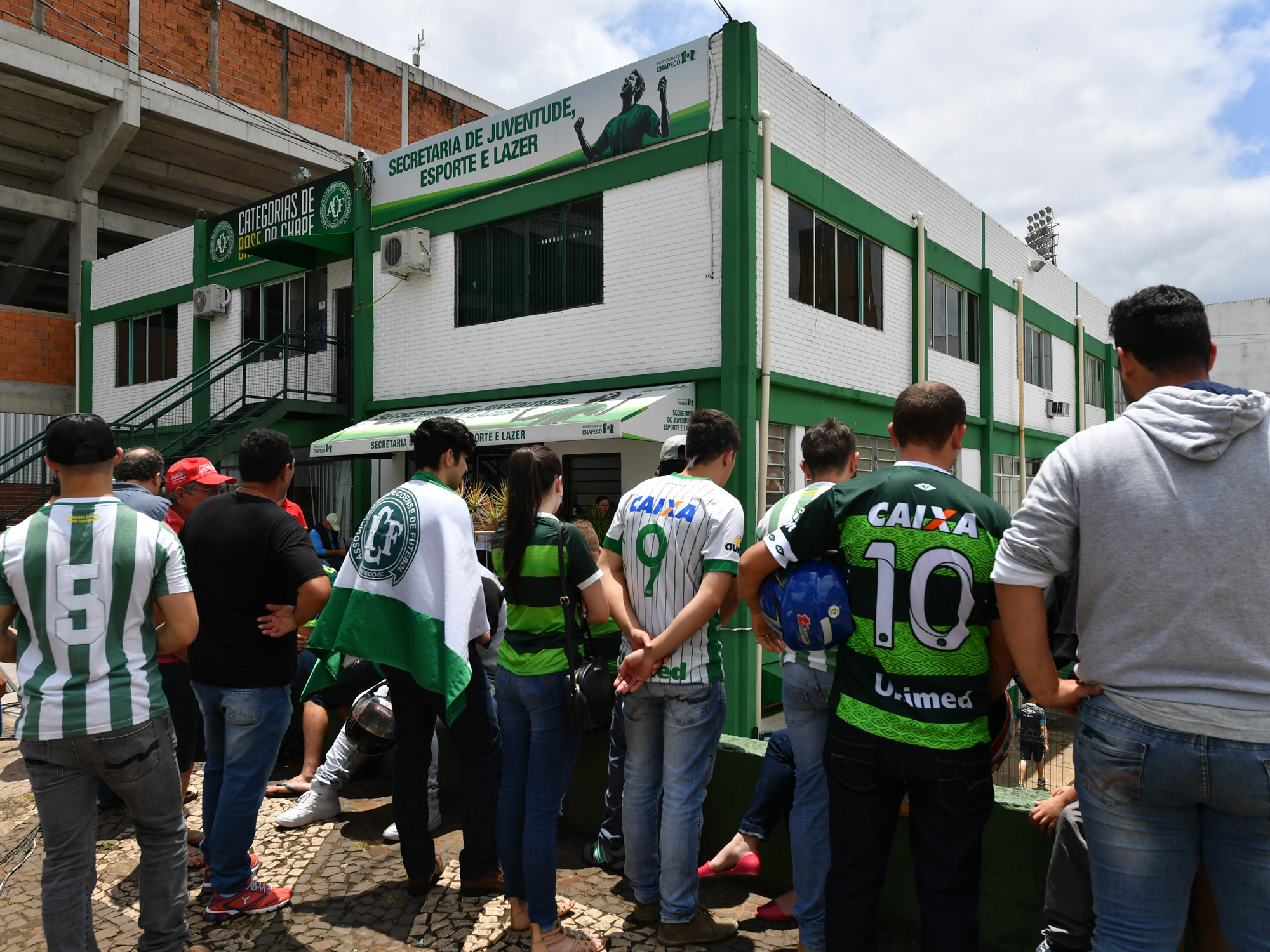 Chapecoense fans gather at the club's stadium to mourn and pray