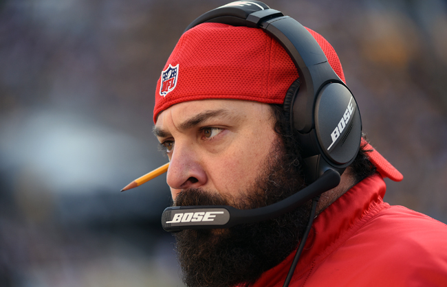 Patriots defensive coordinator Matt Patricia, with signature backward cap and pencil behind ear.