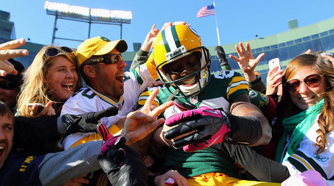 Donald Driver does the Lambeau Leap.