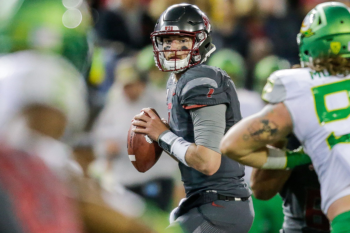 "Falk will be the latest Mike Leach quarterback to have his video game numbers within the Air Raid offense picked apart by NFL scouts in the evaluation process, but his 6' 4"" frame and steadily improving efficiency should get him drafted. He brought the Cougars from Pac-12 doormats to the doorstep of the conference title game, but a humbling performance against Washington's elite defense relegated him to a matchup with Minnesota and fellow NFL-bound QB prospect Mitch Leidner."