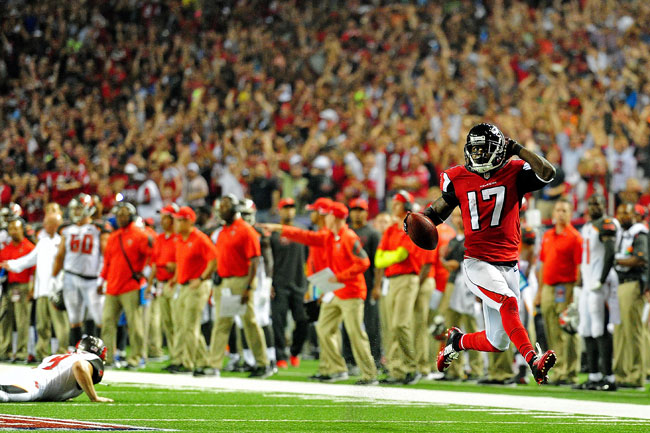 Devin Hester, shown returning a punt for a touchdown in 2014, has more combined return touchdowns (14 on punts, five on kickoffs) than anyone else in NFL history.