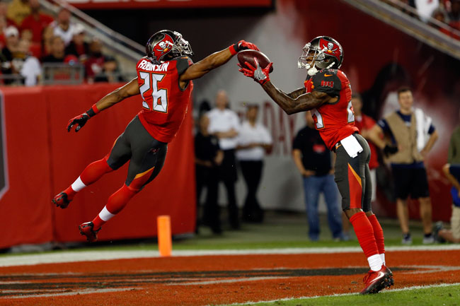 The Buccaneers' Ryan Smith (29) and Josh Robinson (26) keep the ball out of the end zone on a punt while Alan Cross (not pictured) downs it at the 1-yard line against the Saints Dec. 11.