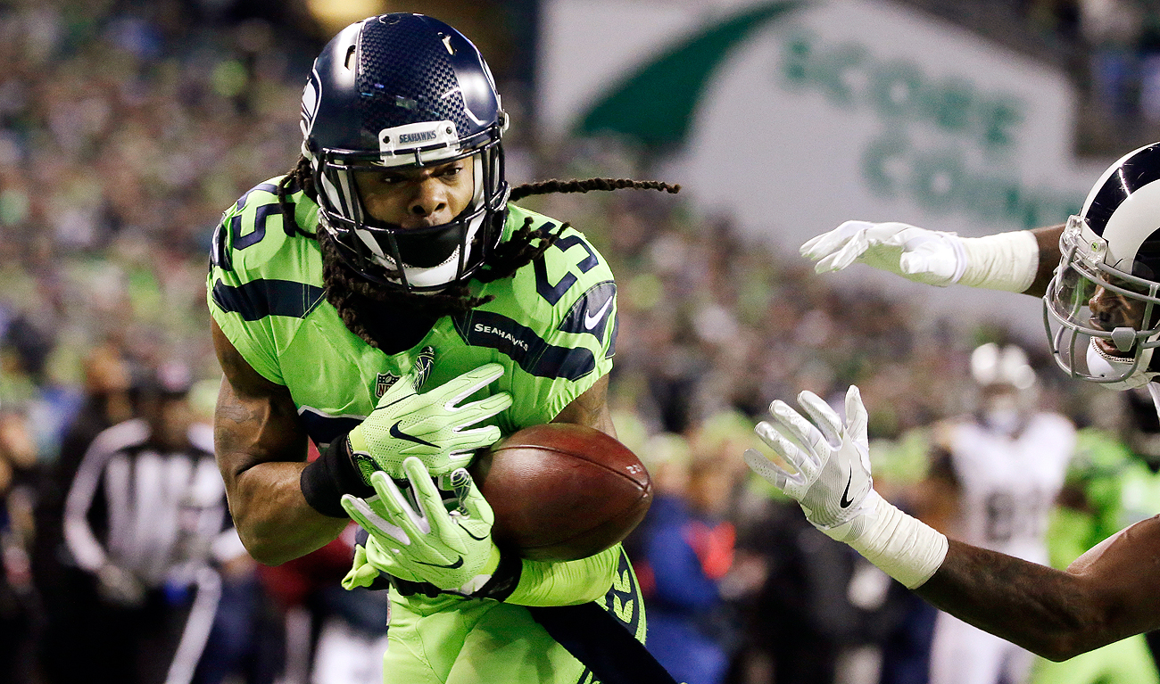 Richard Sherman, here dropping an interception in the end zone, sounded off on some of the offensive play calls in Seattle's win over Los Angeles.