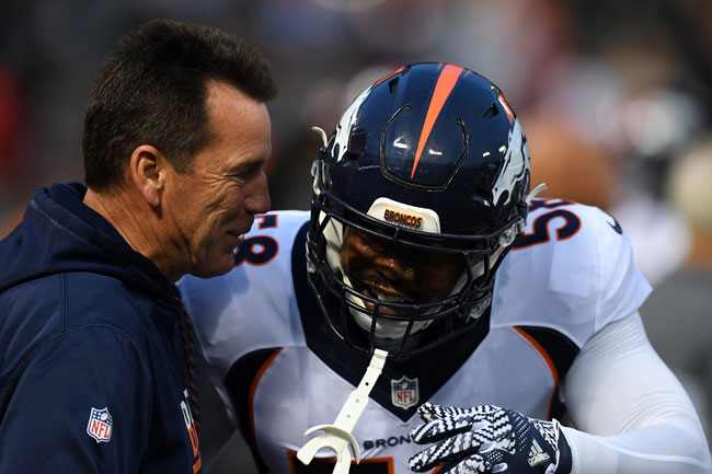 Gary Kubiak and Denver Broncos linebacker Von Miller.