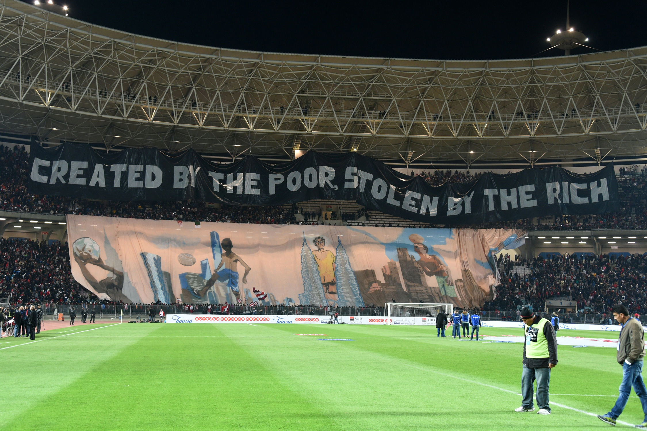 Fans of Tunisia's Club Africain display this pointed tifo at a friendly against PSG, whose Qatari owners have pumped millions and millions into the club.