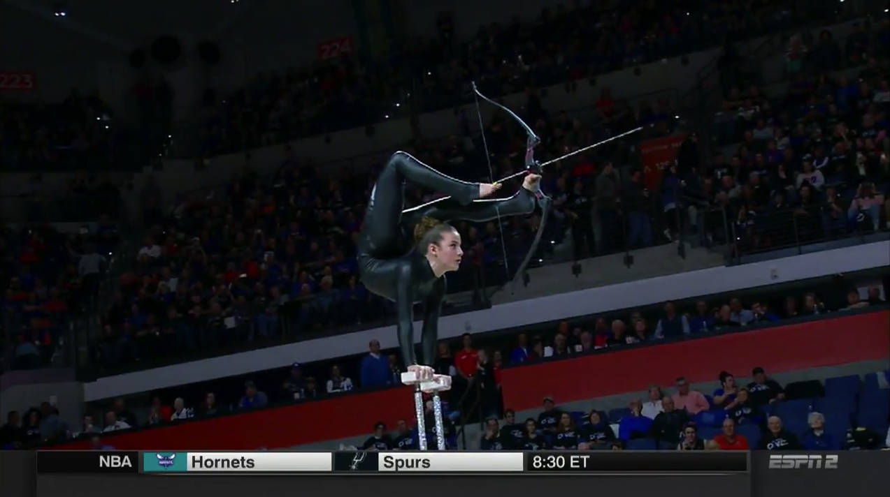 Bow and arrow shot with feet during halftime performance (Video) | SI.com