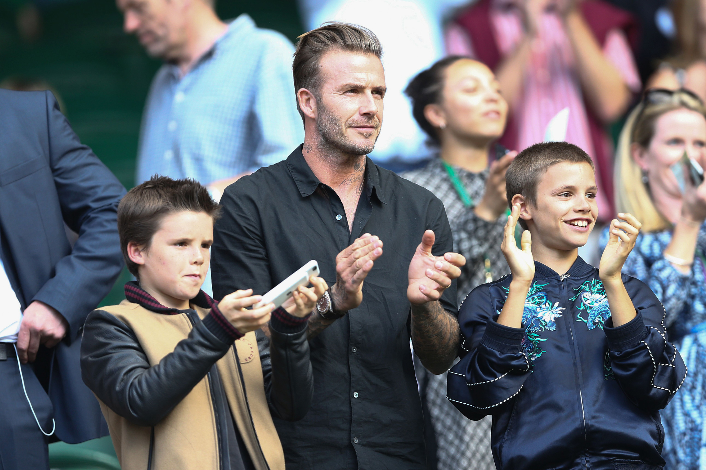 Beckham takes in one of Roger Federer's matches at Wimbledon 2016 with his sons Cruz and Romeo.