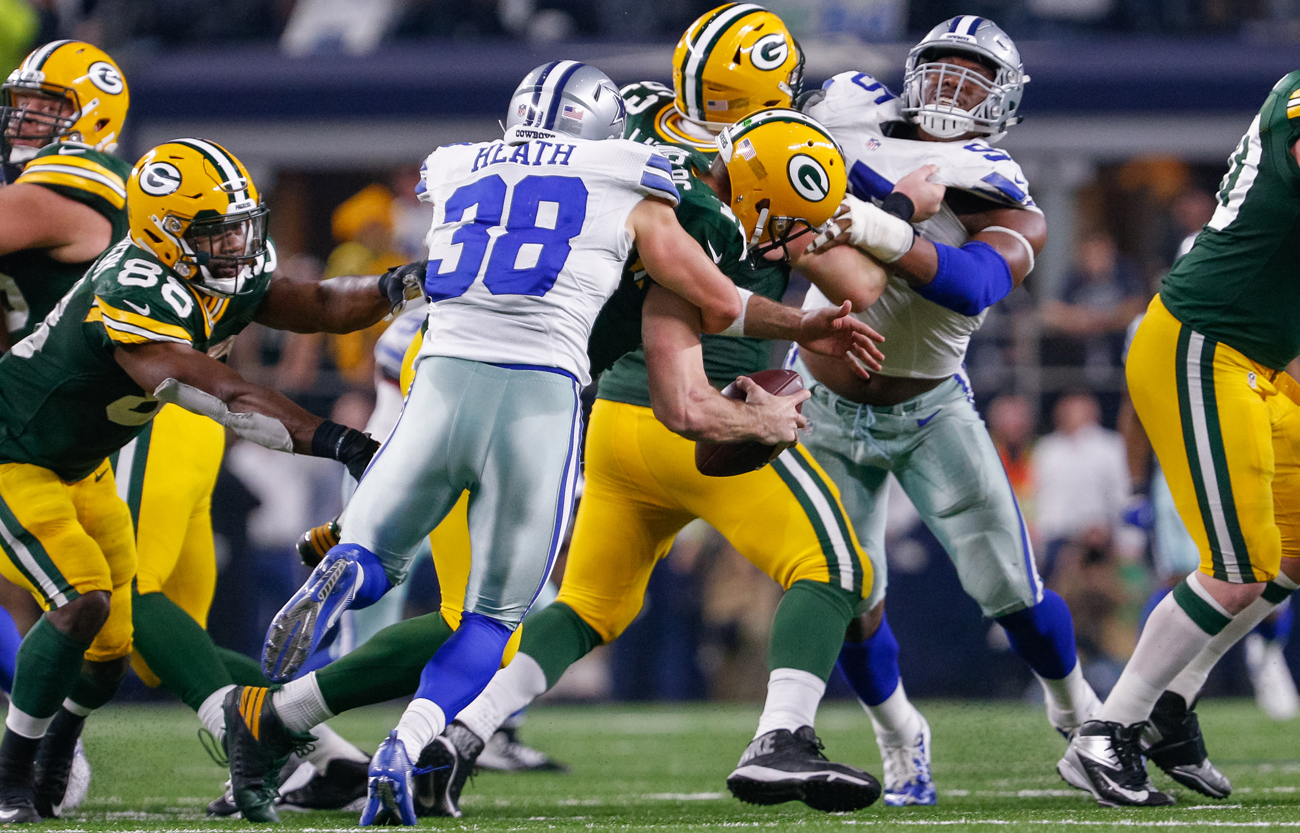 Aaron Rodgers' ability to hold onto the ball after this blindside sack by Jeff Heath set the stage for the next play.