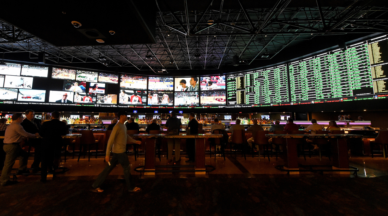 The Westgate Race and Sports SuperBook features a wall of screens displaying all the day's games and betting lines.