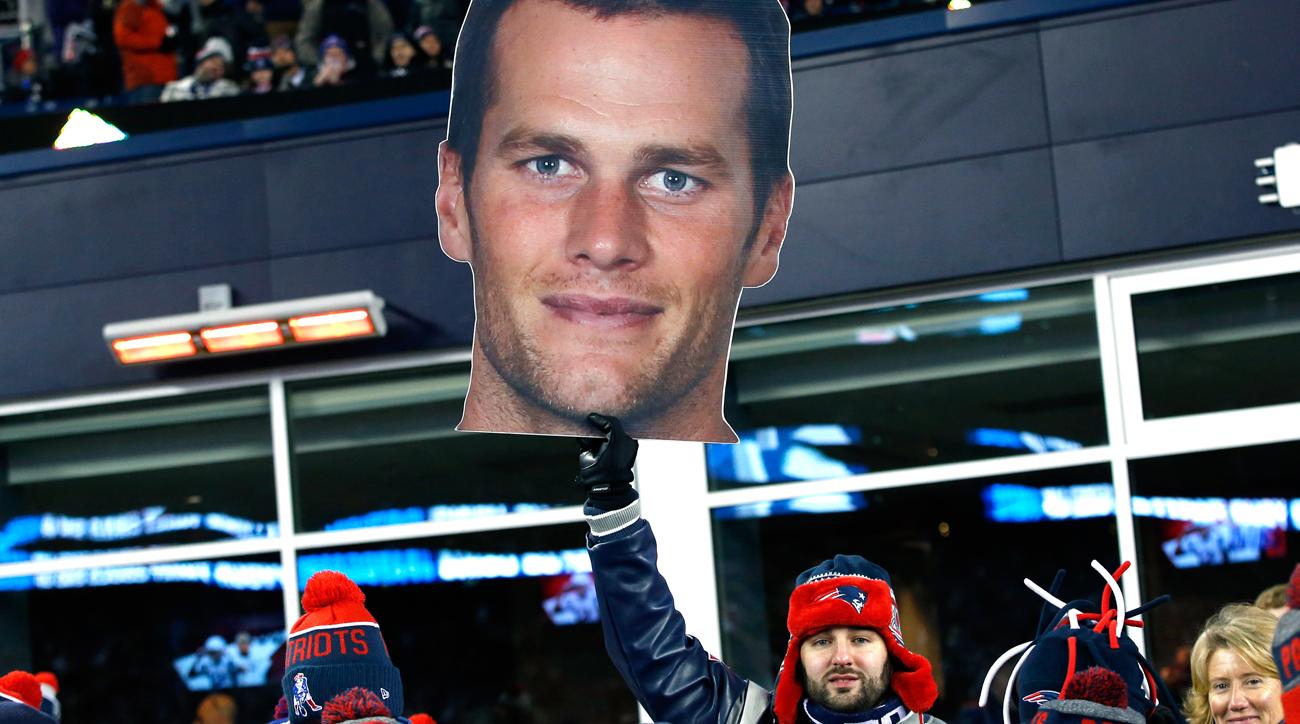 Patriots fan holds up a Tom Brady sign.
