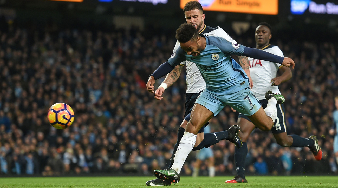 Raheem Sterling is pushed by Kyle Walker in Manchester City's draw vs. Tottenham
