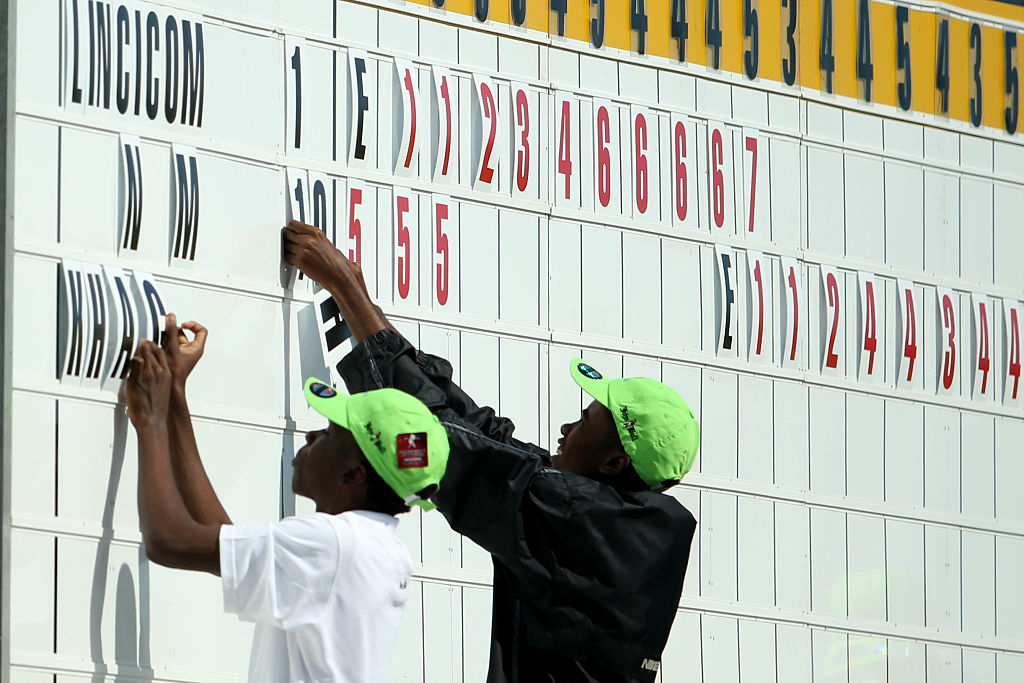 Attendants fill in the leaders on the scoreboard at the LPGA's Pure Silk Bahamas Classic during round one.