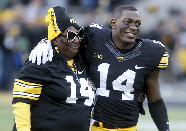 Desmond King and his mom at Iowa's Senior Day ceremonies.
