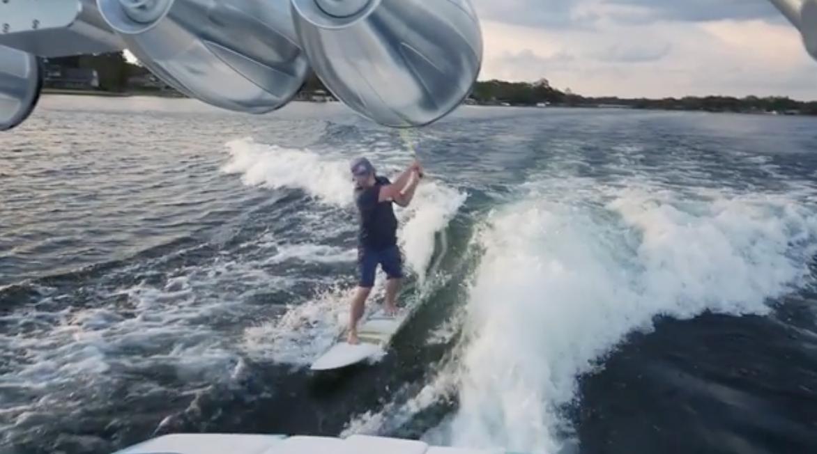 A boat + wakeboard = a legit trick shot.
