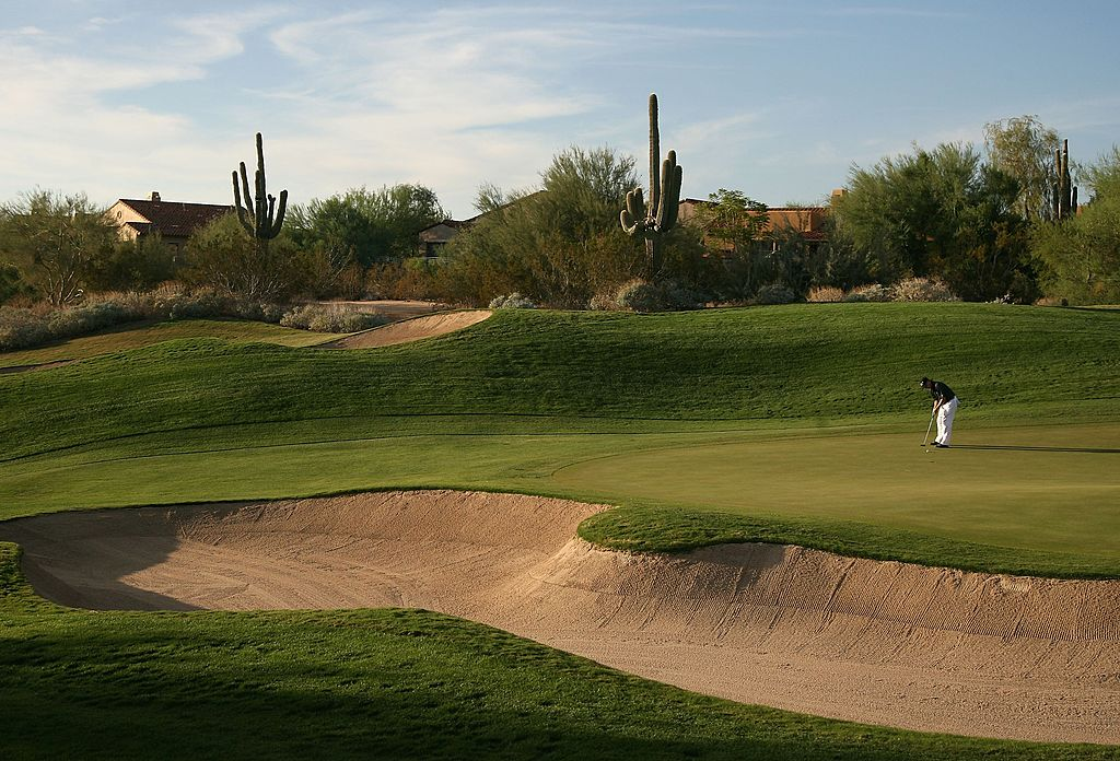 A golfer putts on the 8th hole green at the Grayhawk Golf Club in Scottsdale, Arizona.