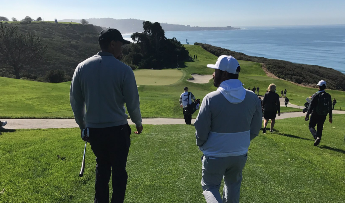 Tiger Woods and JJ Spaun chat at Torrey Pines during the 2017 Farmers Insurance Open.