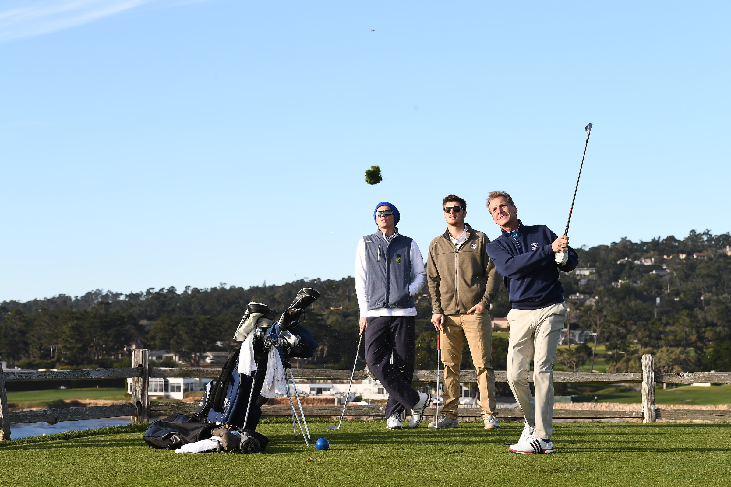 Harper, on the 7th tee at Pebble Beach, passed his love for golf on to his two sons, Tucker (far left) and J.T. (center).