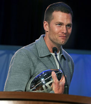 Tom Brady tucks away his Super Bowl MVP trophy on Monday morning.