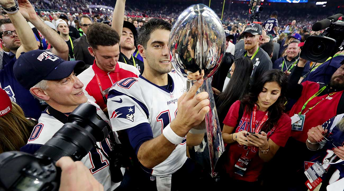 Quarterback Jimmy Garoppolo holds up the Lombardi Trophy after the Patriots' Super Bowl 51 victory.