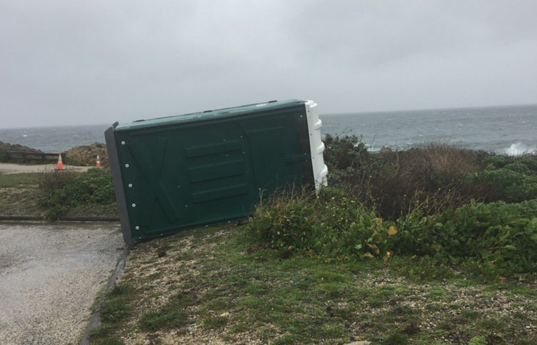 Not even a local port-a-potty was able to stand up to Mother Nature Tuesday at Pebble Beach.