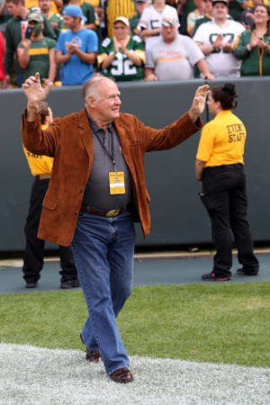 Kramer is introduced during a Packers' alumnus ceremony last September at Lambeau Field.