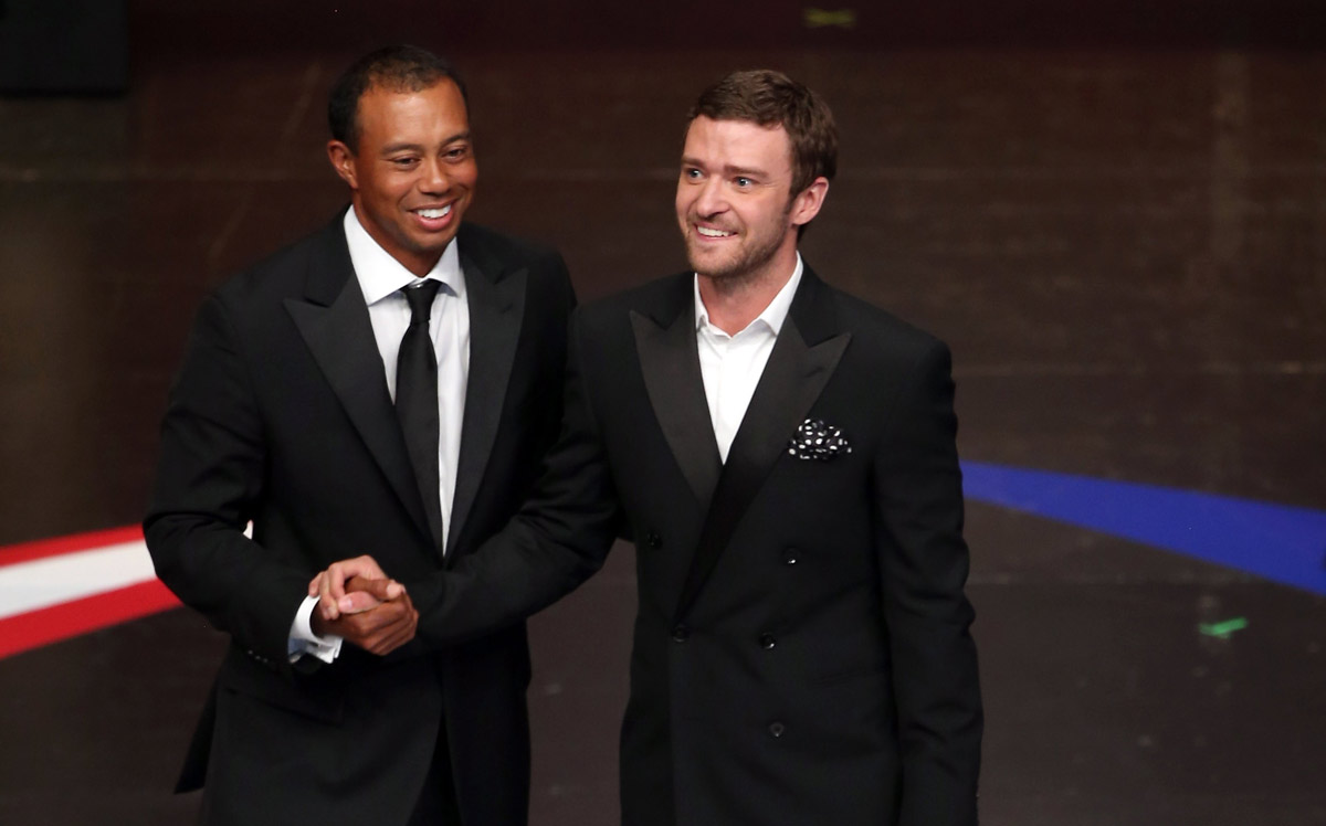 Tiger Woods talks with Justin Timberlake during the 39th Ryder Cup gala on September 26, 2012