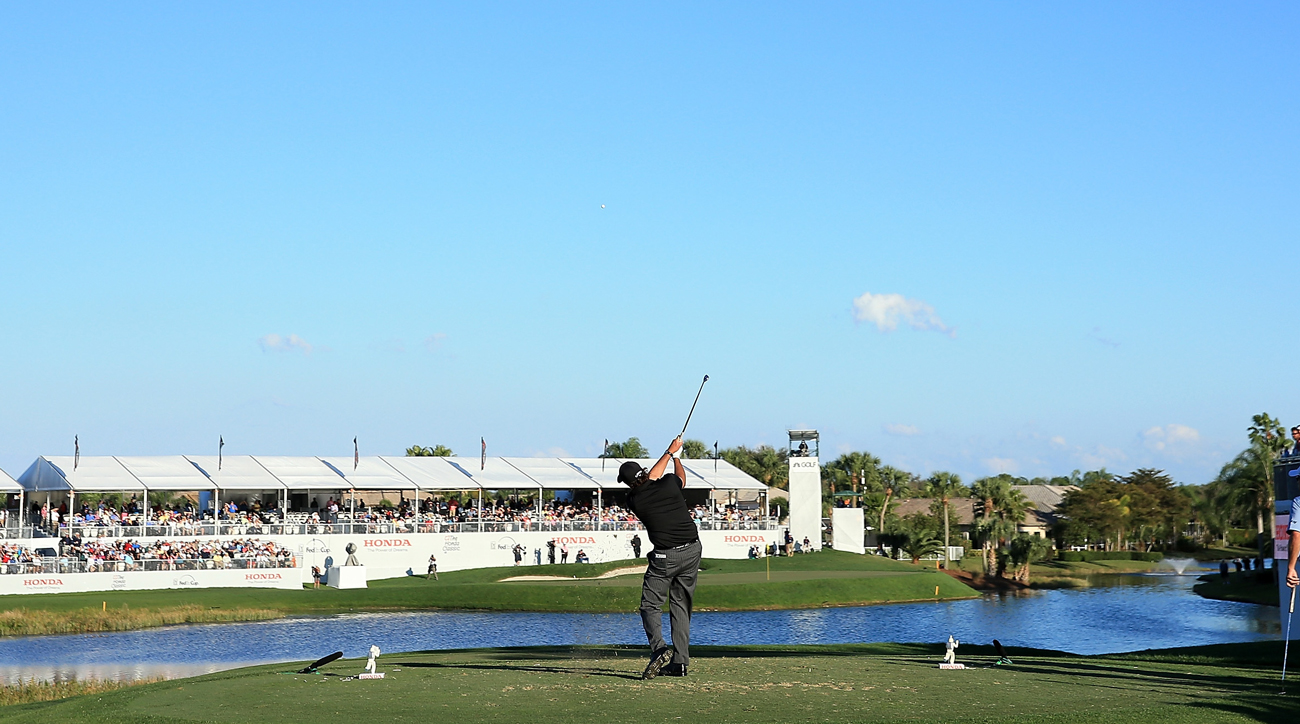 Phil Mickelson hits his tee shot on the par-3 17th at PGA National's Champion Course.