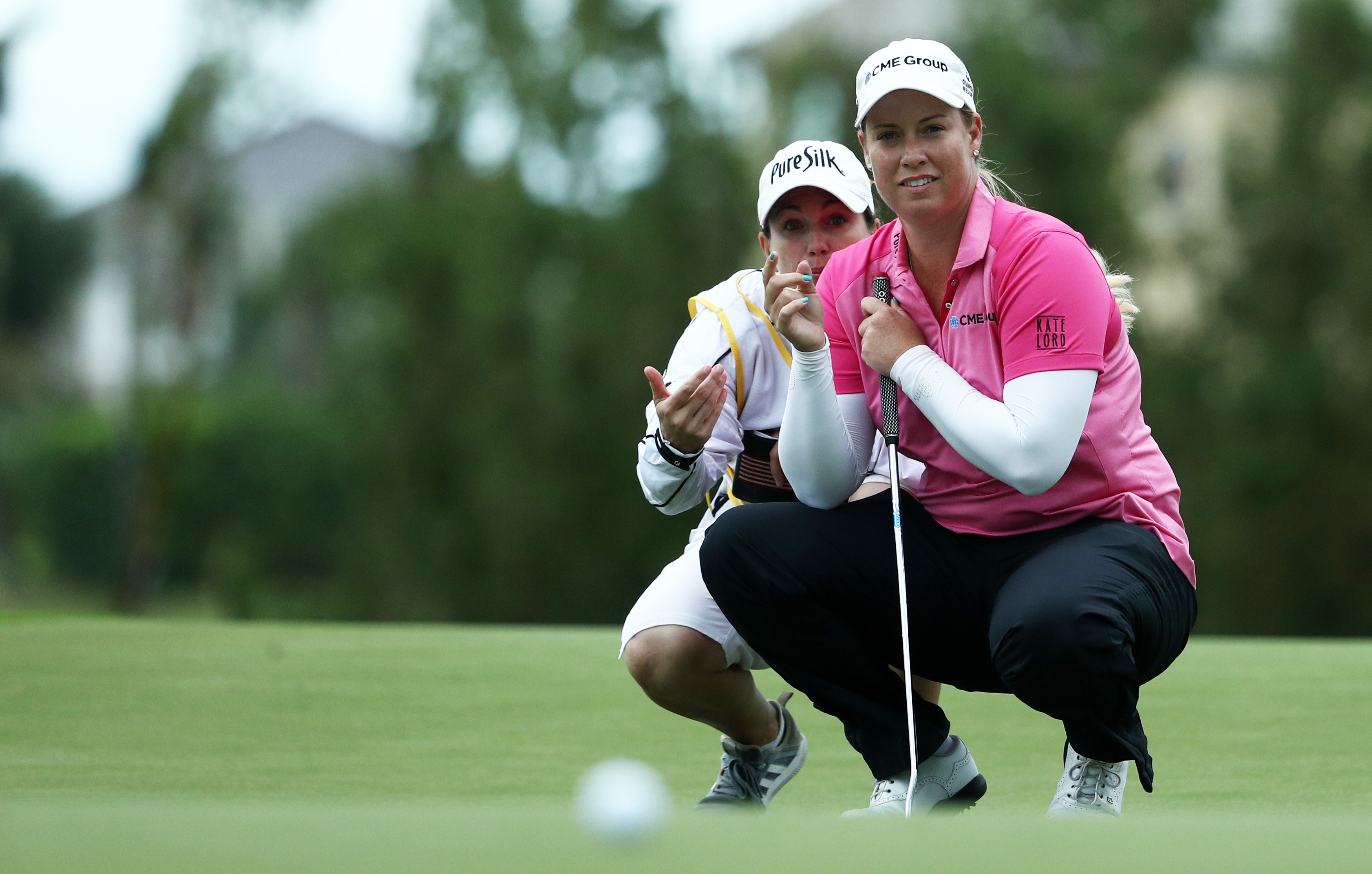 Brittany Lincicome and caddie Missy Pederson line up a putt at the 2017 Pure Silk Bahamas LPGA Classic.