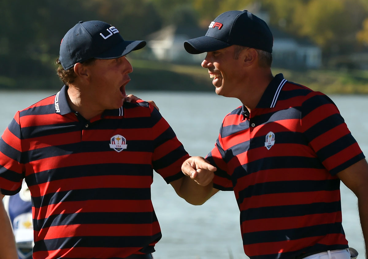 Team USA's Phil Mickelson and Matt Kuchar celebrate in the afternoon Fourball matches during the 41st Ryder Cup.