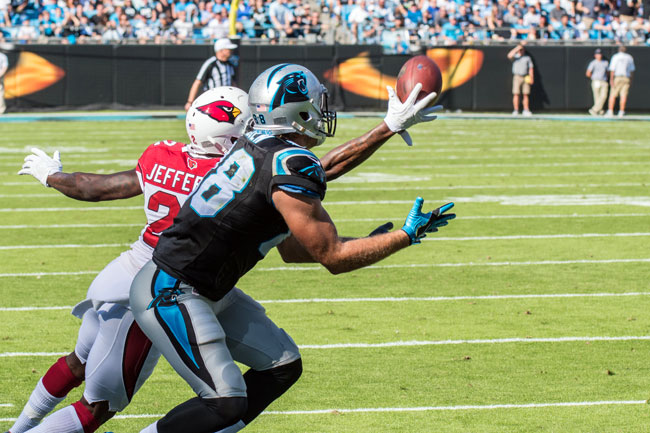 Jefferson gets in front of Panthers tight end Greg Olsen last October.