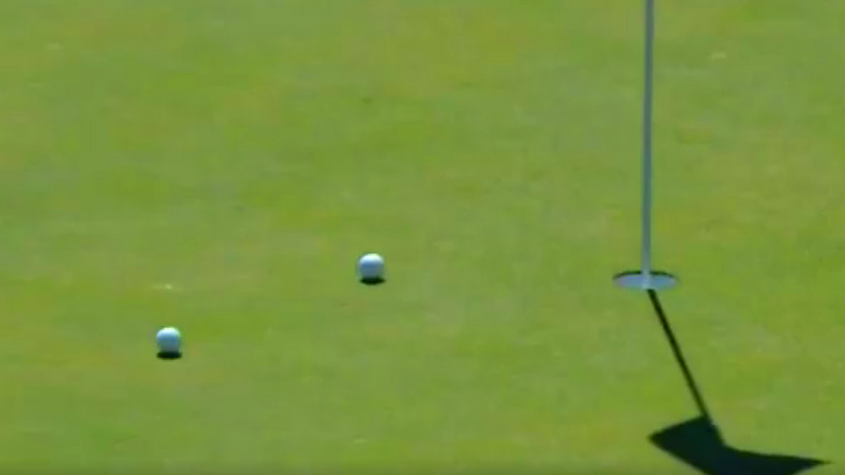 Zach Johnson's ball heads for the hole after banking off his playing partner's ball.