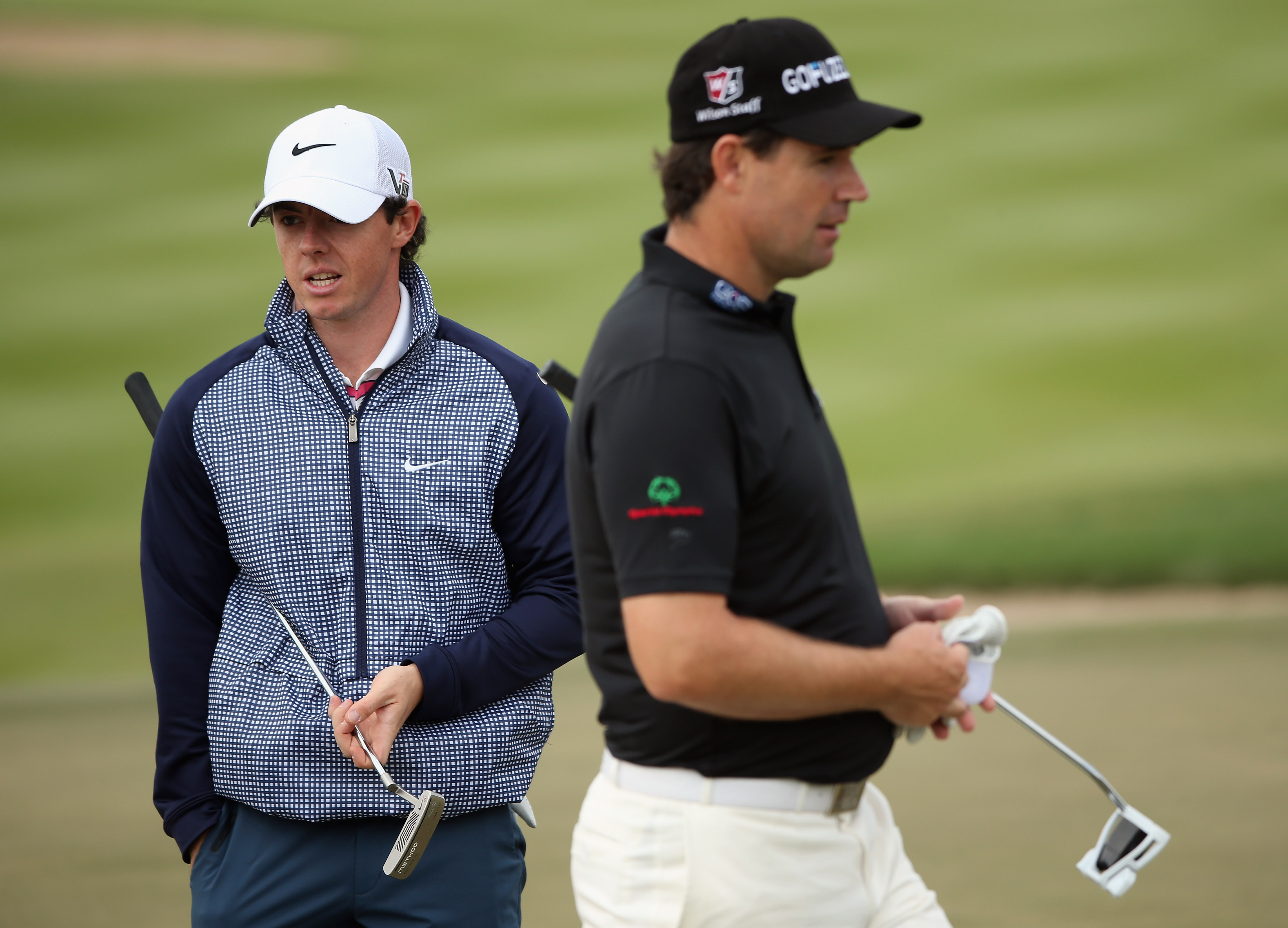 Rory McIlroy and Padraig Harrington are pictured together during practice for The Abu Dhabi HSBC Golf Championship on January 15, 2013