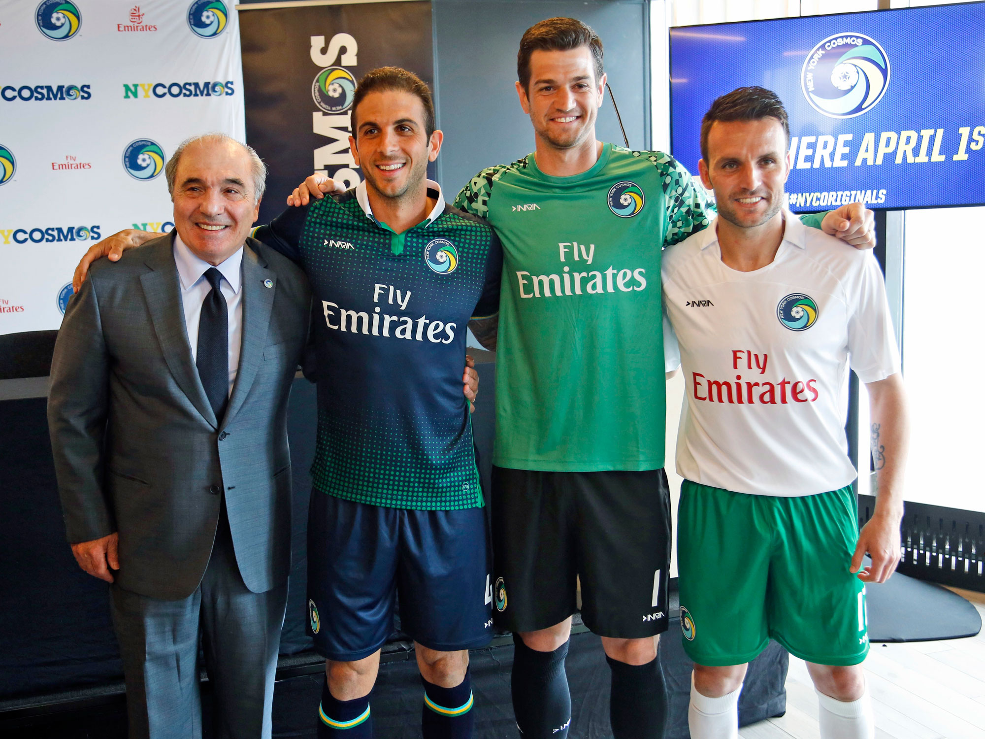 Rocco Commisso stands with three of his New York Cosmos players