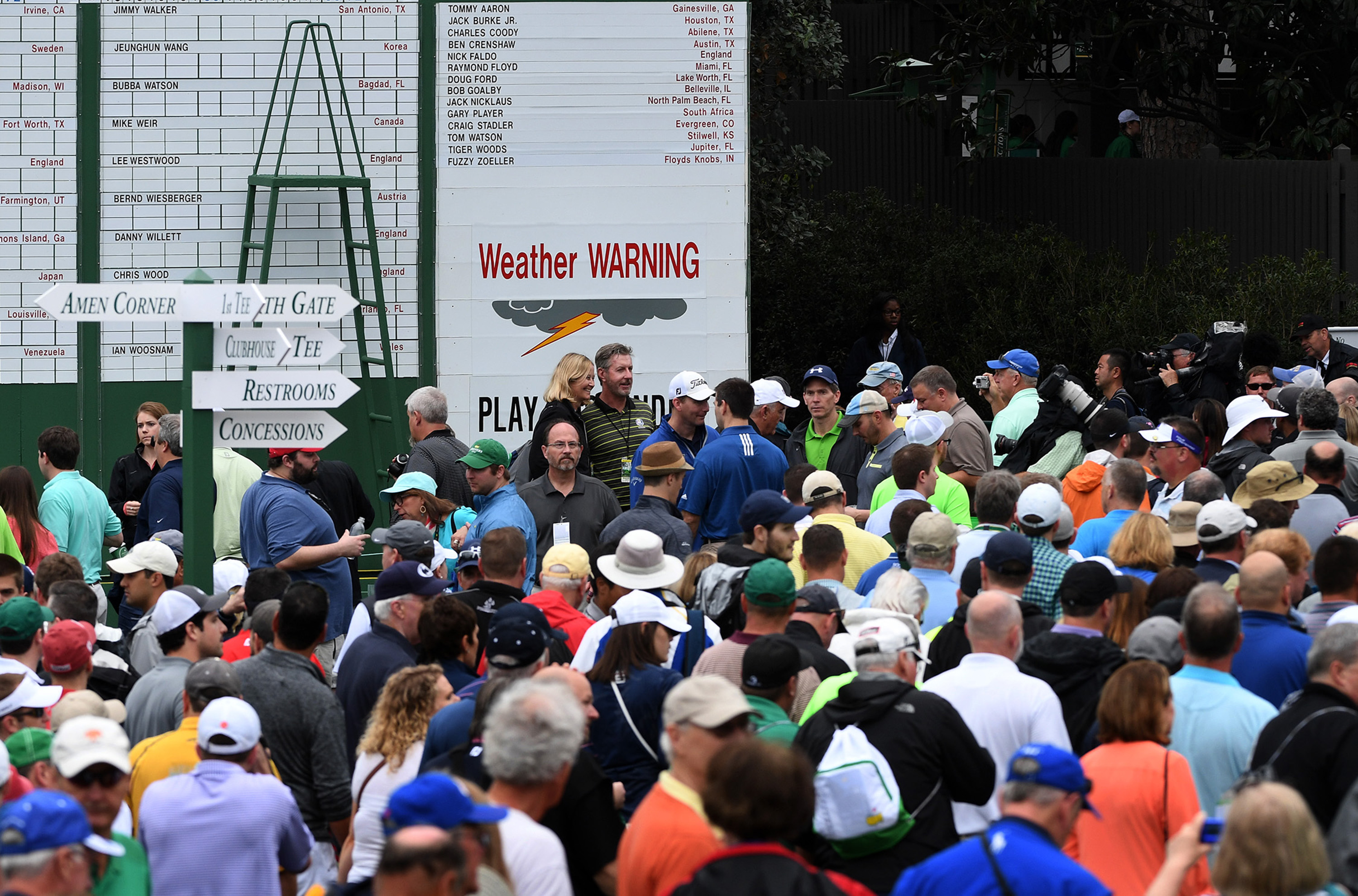 Patrons leave the course at Augusta National Golf Club as inclement weather approaches on Wednesday.