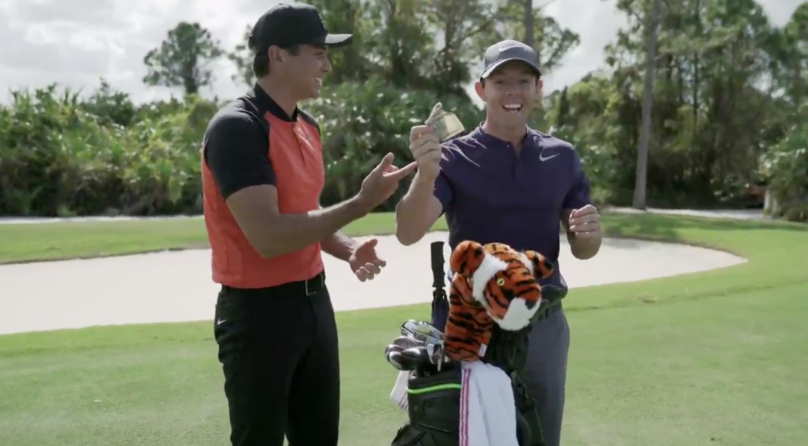 It was all fun and games until Rory McIlroy touched Tiger Woods's head cover.