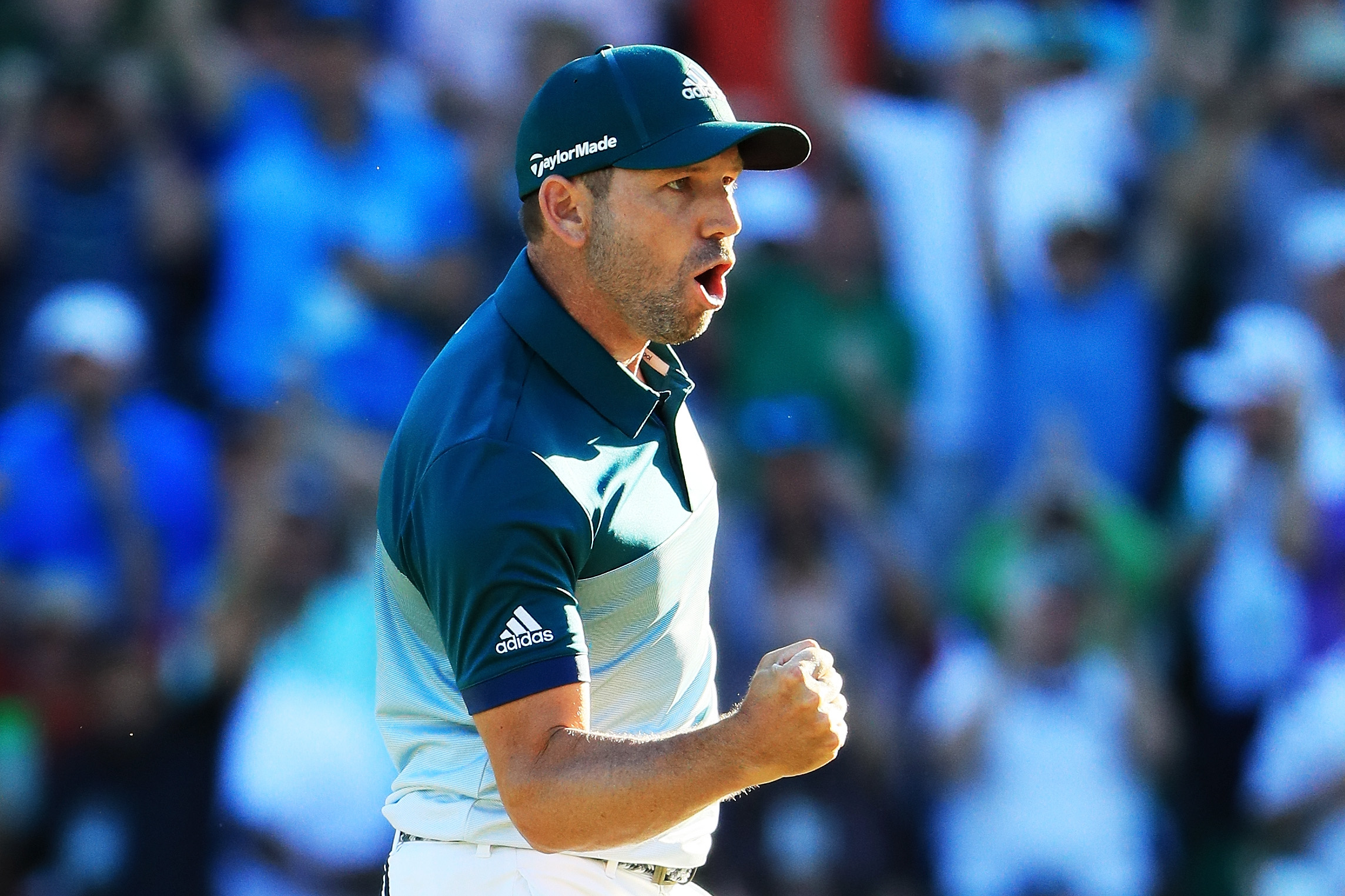 Sergio Garcia celebrates his eagle putt on the 15th hole on Sunday at the Masters.