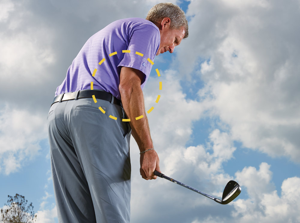 Because your left arm is pinned against your chest, it's impossible to make more than a two-foot backswing. That's a good thing! The chipping motion has to be short, but everyday golfers tend to overdo it. As you take the club back, simply hinge your wrists and let your right elbow fold. The club will swing up, not behind you. You're on-plane, primed to deliver a crisp strike.