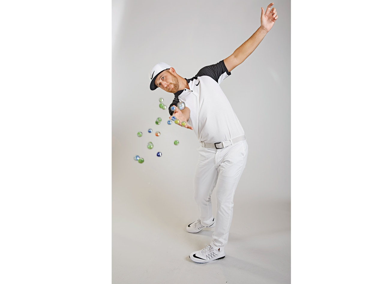 As you swing though the ball, imagine where a handful of marbles would land if you let them go right at impact. The goal is to toss them straight down the target line. If the marbles shoot out to the left or right, do what I do and keep tossing—eventually your swing will find the right plane. It also improves your attack angle. With driver, the marbles should shoot out horizontally. With irons, you want the marbles to hit the turf a few feet in front of the ball.