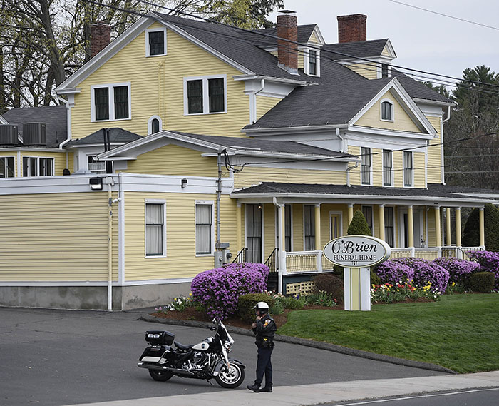 A police officer stands outside the funeral home.