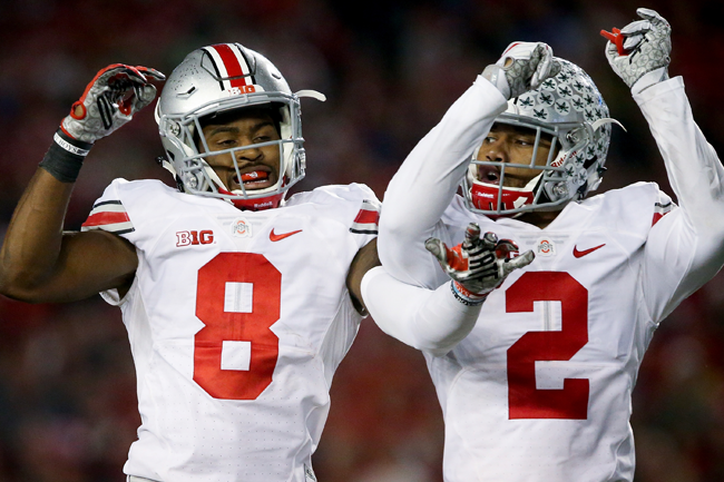 Ohio State's Gareon Conley (No. 8) and Marshon Lattimore celebrate Conley's interception at Wisconsin last season.