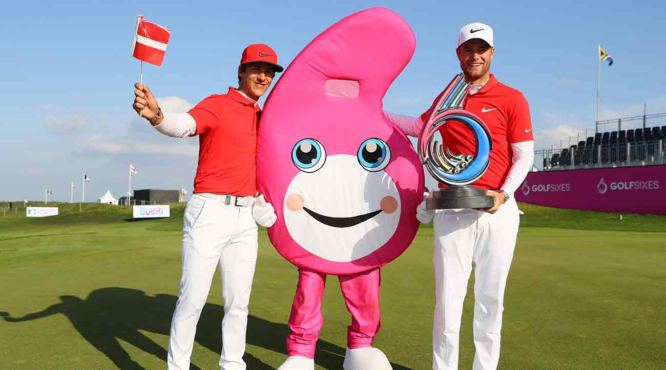 Thorbjorn Olesen and Lucas Bjerregaard of Denmark pose with the trophy and the GolfSixes mascot after winning the final match between Denmark and Australia during Day 2 of GolfSixes at The Centurion Club Sunday.