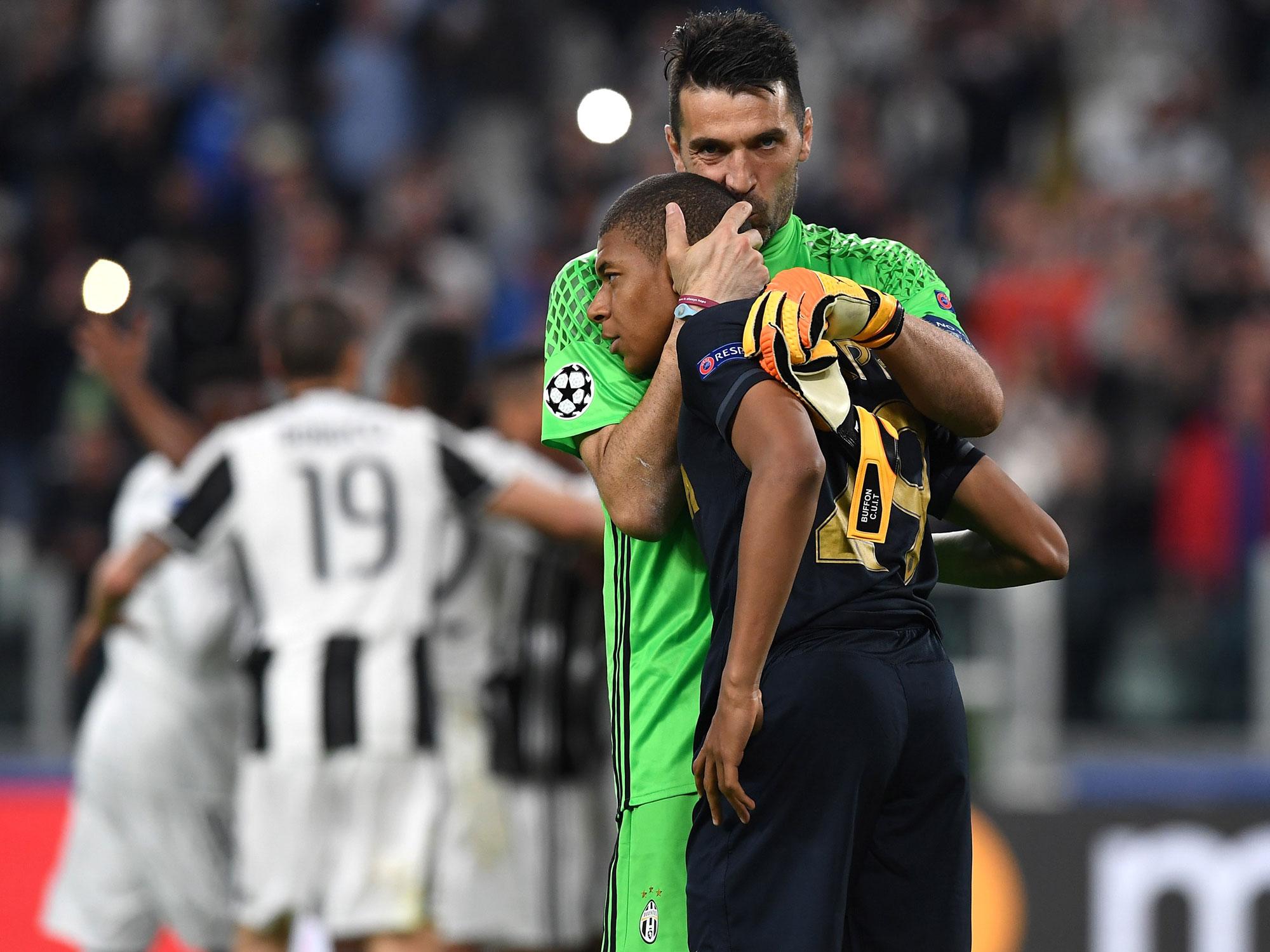 Monaco star Kylian Mbappe is embraced by Juventus goalkeeper Gianluigi Buffon